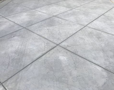 this image shows stamped concrete driveway patio