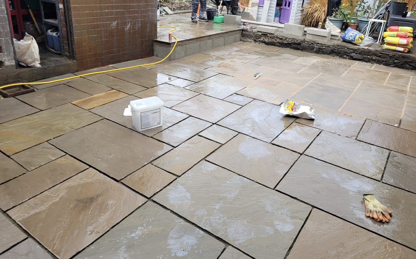 this image shows stained patio in Fullerton, California